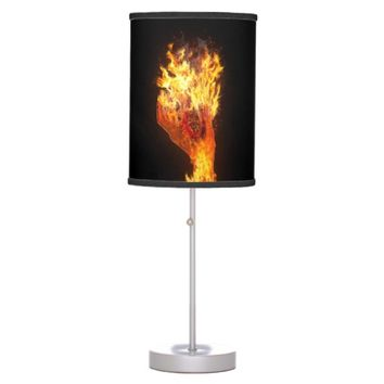 Hand on fire table lamps