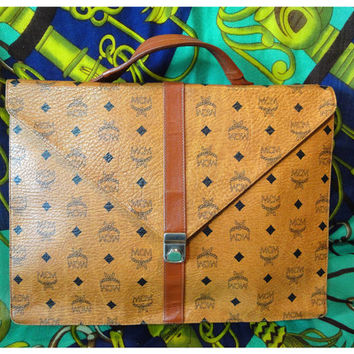 Vintage MCM rare brown monogram briefcase, business document bag with leather handle. Great masterpiece for unisex use.