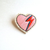 Heart brooch embroidered with pink, red and blue lightning bolt on cream muslin with cream felt back Valentines day David Bowie tribute