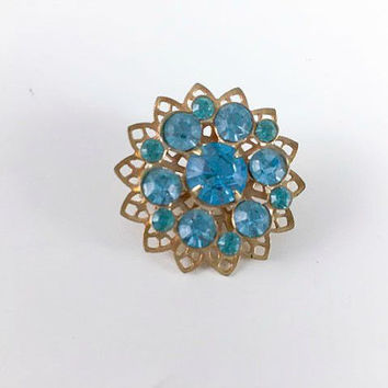 Vintage Blue Turquoise Teal Rhinestone Gold Toned Starburst Brooch Mid Century Flower Costume Jewelry Retro Atomic Pin