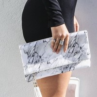 Flat Rectangular White Clutch With Tassel Detail