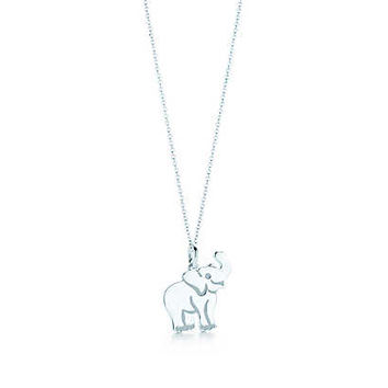 Tiffany & Co. - Elephant tag charm in sterling silver on a chain.