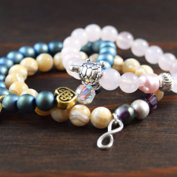 Women's Triple Stack with Rose Quartz, Blue Hematite, and Mother of Pearl. Turtle Bracelet. Buddha Bracelet. Lotus and Lava Bracelets.