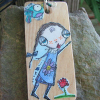 "Wood, decoupage pendant decorated with Sunny Carvalho's ""Lucy Loves Life"" Art stamps"