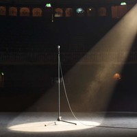 single spot light on stage with microphone - Google Search