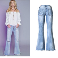 Vintage bell bottoms ripped & faded jeans with frayed hems