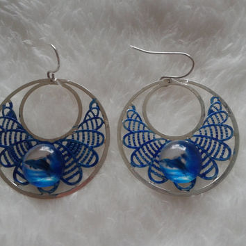 Dolphins glass cameo silvertone round blue dangle earrings