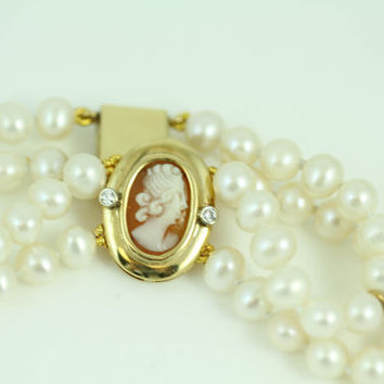 Sale - Antique Shell Cameo Framed in 14kt Yellow Gold and Diamonds on a Double Stranded Pearl Bracelet