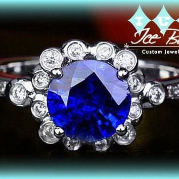 Ceylon Blue Sapphire Engagement Ring 1.10ct Round set in a 14k White gold bezel set diamond halo setting