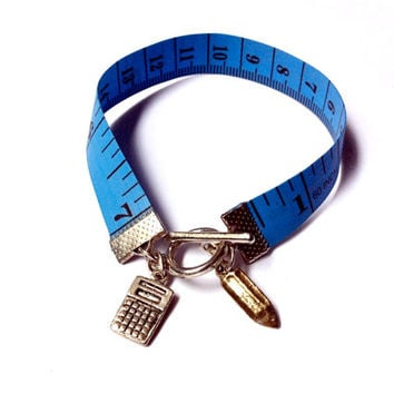 Number Cruncher: tape measure bracelet with calculator and pencil charms