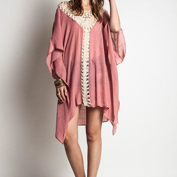 This simply chic caftan dress features a crochet deep v-neckline at front and back, semi-sheer crochet trim at center down, short butterfly sleeves with draped at side, boxy cut fitting. Unlined.