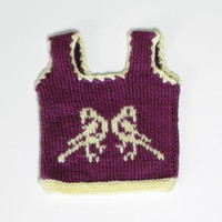 Knitted baby vest with parrot pattern in purple color