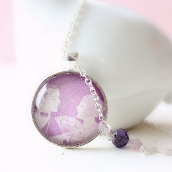 Flapper necklace made with vintage 1920s art deco style artwork from sheet music illustration in lavender purple