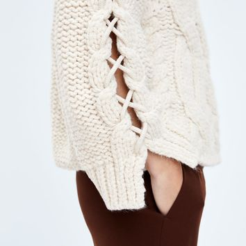 BRAIDED CABLE KNIT SWEATERDETAILS