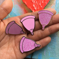 "1.25"" Menstrual Cup Lapel Pin in pink, glitter, gold and black nickel"