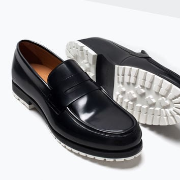Leather moccasins with rubber sole
