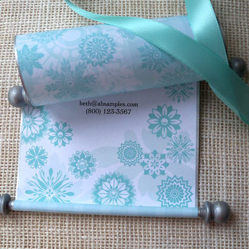 Princess invitation scrolls with snowflakes, in aqua and silver