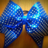 Royal blue rhinestone cheer bow.