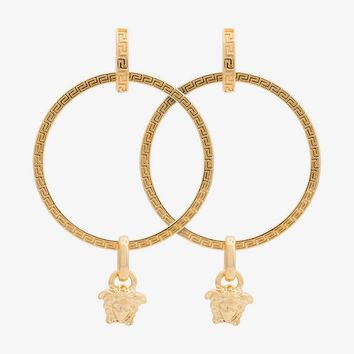 gold metallic medusa hoop earrings