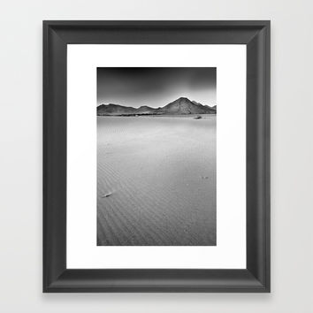 Volcanoes and sand Framed Art Print by Guido Montañés