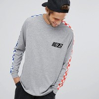 ASOS Oversized Long Sleeve T-Shirt With Checkerboard Print And Chest Embroidery at asos.com
