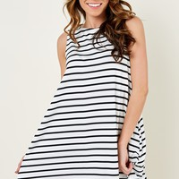 Putting Class In Classic White Striped Dress