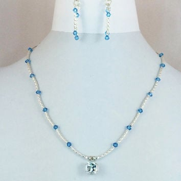 Faceted Pale Sky Blue Topaz Pendant Necklace with Sky Blue Swarovski Crystals and Sterling Silver Twisted Tube Beads -- Product N092