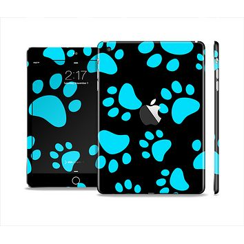 The Black & Turquoise Paw Print Skin Set for the Apple iPad Mini 4