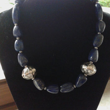 Necklace handmade  with  of lapis lazuli stones,two beads silver colored  and metal beads