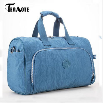 TEGAOTE 2017 Nylon Waterproof Large Capacity Travel Bags Women Travel Duffle Bags Solid Casual Tote Bolsas Travel Luggage 280