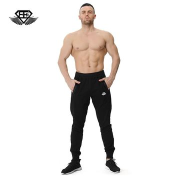 Body engineers 2017 men fitness muscle movement side zipper breathable stretch trousers sweatpants gyms casual Cotton pants