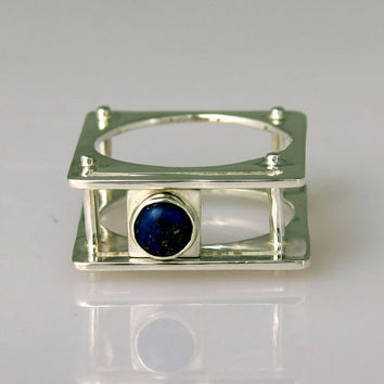 Sapphire Ring with Sliding Stone by aboutjewelry on Etsy