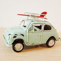 Sky blue miniature car with red surfboard, retro, shabby chic style, collectible