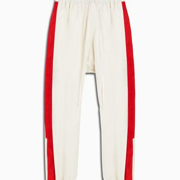 dp parachute track pant / ivory + red