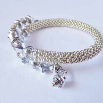 Boho Style Bead Crochet Silver Bracelet with Swarovski Crystals. Silver Memory Wire Bangle with Charms.