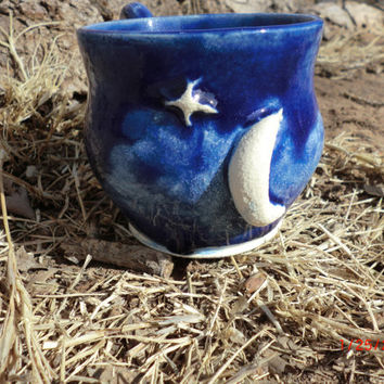 moon and star pottery coffee mug in cobalt blue