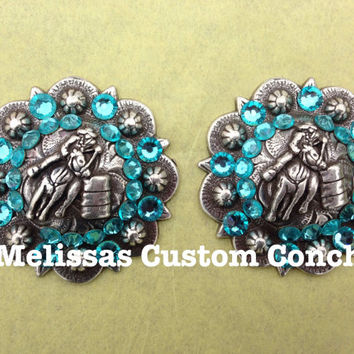 Set of two 1-1/2 inch Barrel Racing conchos. Light Turquoise Swarovski crystals. Regular screw back conchos. Comes with screws.