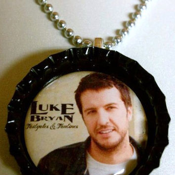 "Luke Bryan Bottlecap Necklace, comes on 18"" silver colored ball chain"