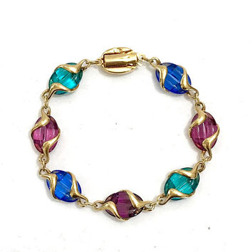 Jewel Tone Swarovski Crystals Bracelet Amethyst Sapphire Turquoise Oval Crystals Wrapped in Gold Tone Metal Swan Signed Vintage Gift for Her