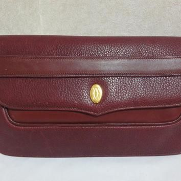 Cartier Vintage Must De Cartier Leather Wine Color Clutch With Gold Tone Charm lldQGGs