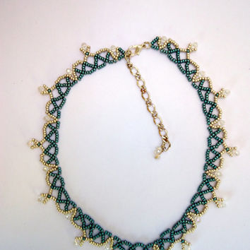 Beaded necklace with pale blue and silver Miyuki seed beads  and clear crystals throughout in a diamond pattern. Handmade.