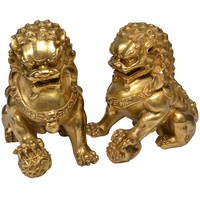 A Pair of Fine Cast Gilt Bronze Figures of The Foo Lions, circa 1930