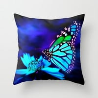 Butterfly in blue light Throw Pillow by Elena Indolfi