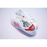 adidas superstar sneaker white red b27139
