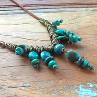 Turquoise Cairns on leather with antique brass. African Turquoise, Colorado Turquoise, Peruvian Turquoise, New mexico turquoise