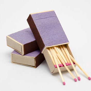 Three matchboxes, wooden matches with pink heads inside, striker from two sides, color matchsticks
