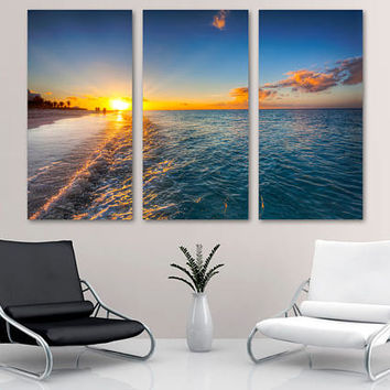 Beach during Sunset 3 Panel Split (Triptych) Canvas Print.  Yellow and blue skies nature photography for interior room wall decor.