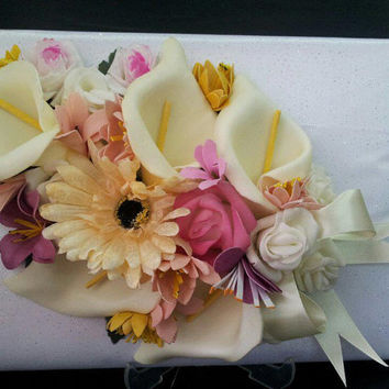 wedding guest book covered with satin and tole fabrics staffed with sponge and topped with spring colors flowers
