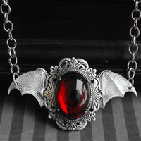 Wings of the Night - antique silver short necklace with bat wings and red glass cabochon