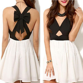 2015 New Fashion Sexy Women Dress Sleeveless V-neck Hollow Out Summer Party Dress Backless Dress With Bow = 1932325956